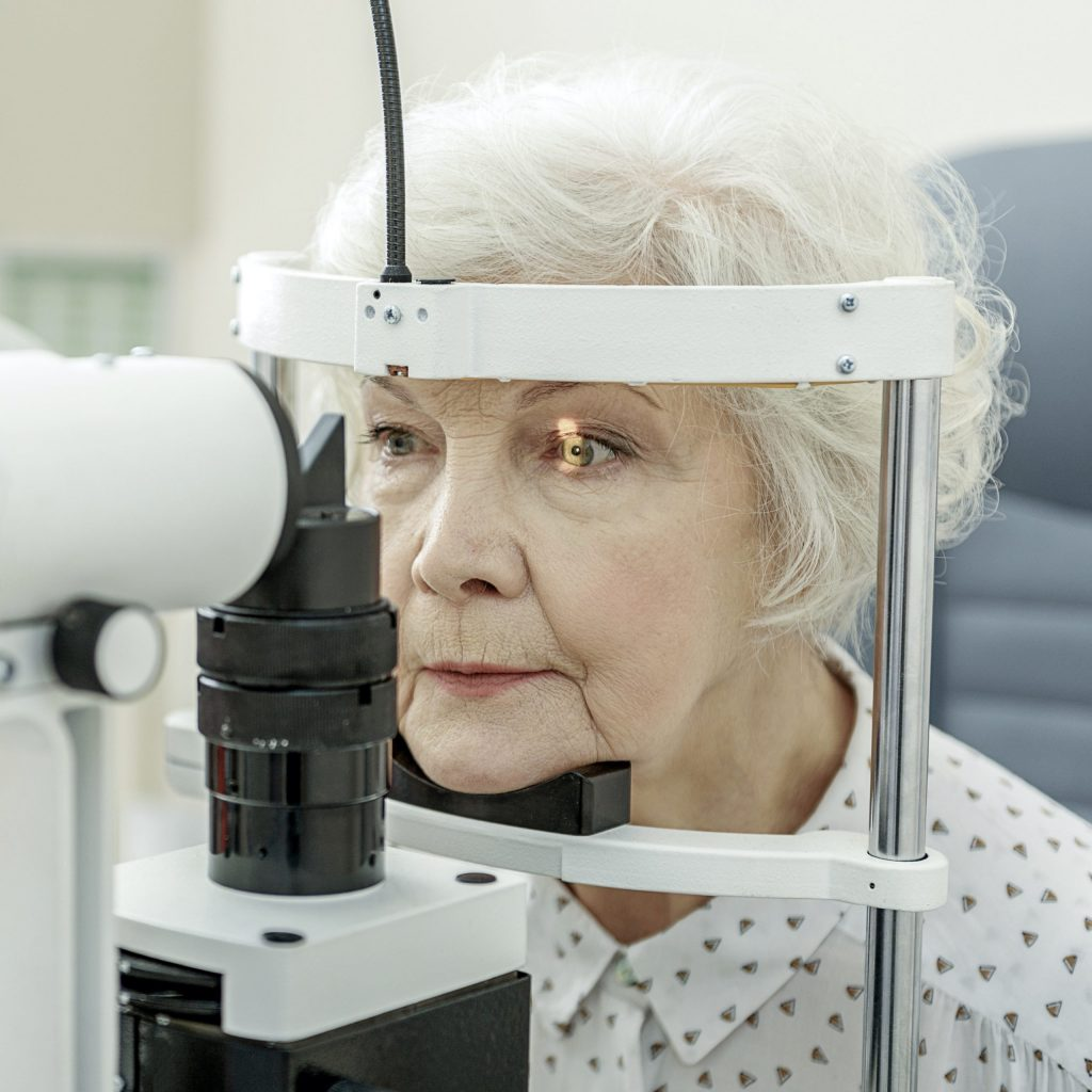 An elderly woman undergoes an eye exam at her ophthalmologist.